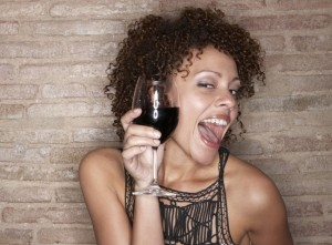 Shot in Barcelona, Spain, woman holding red wine